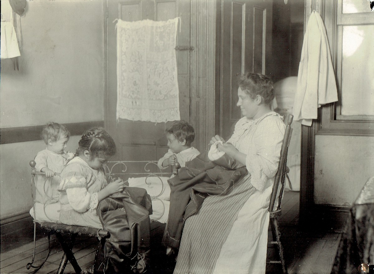 N.Y. tenement. Little ones helped in homework